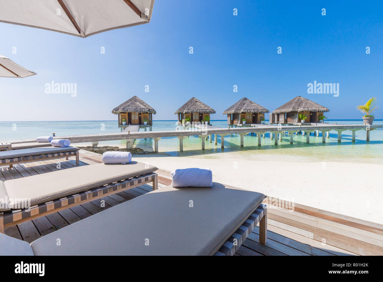 Luxury water villas in Maldives, tropical resort or hotel background. Exotic travel destination and Stock Photo