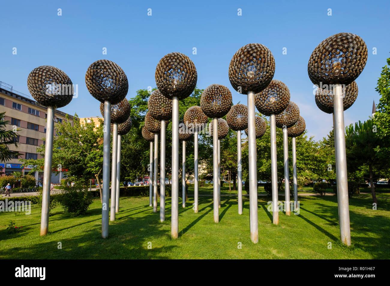 Flower sculptures from ammunition and weapons in the municipal park, Shkodra, Shkodër, Qark Shkodra, Albania - Stock Image