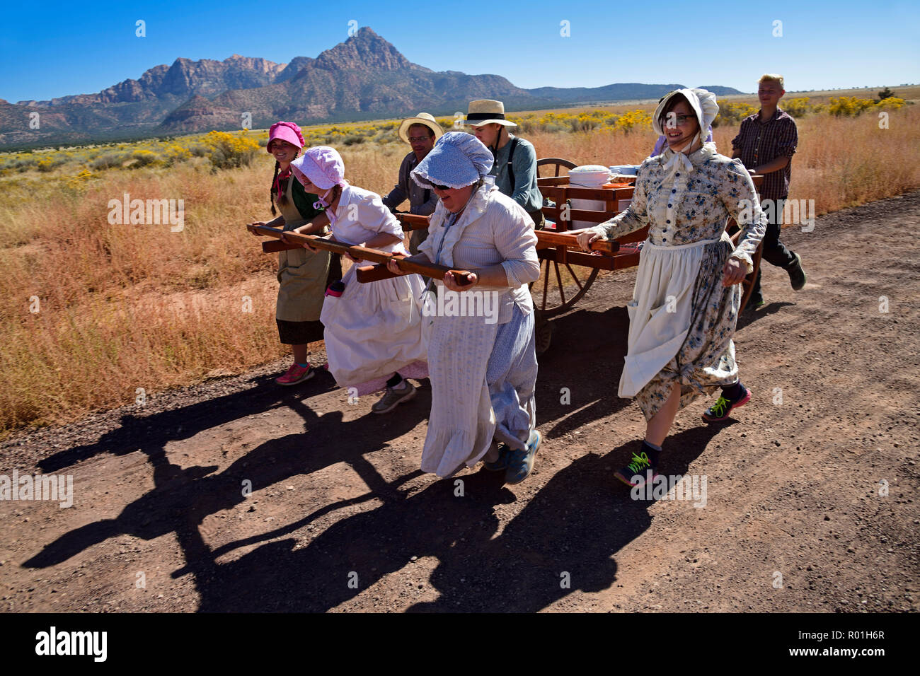 Mormons with handcarts recreate the harsh conditions of colonizing the American West, Hurricane, Utah, USA - Stock Image
