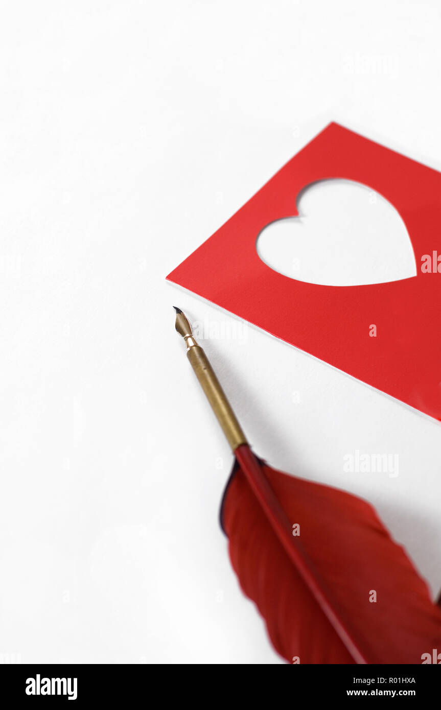 Love Your Heart Letter With a Red Feather Pen - Stock Image
