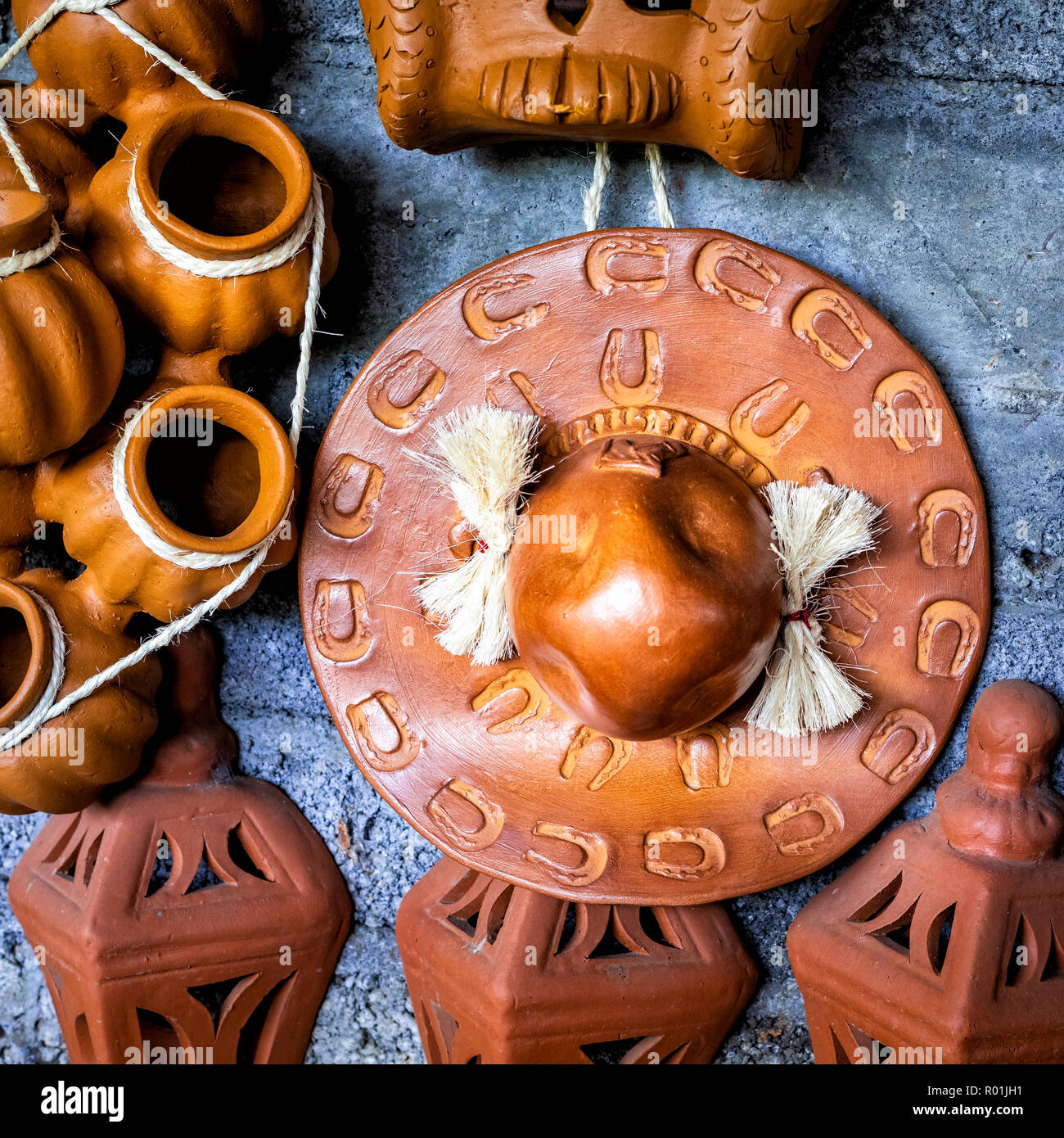 Clay cowboy hat hangs in a market in Capula, Michoacan, Mexico. - Stock Image