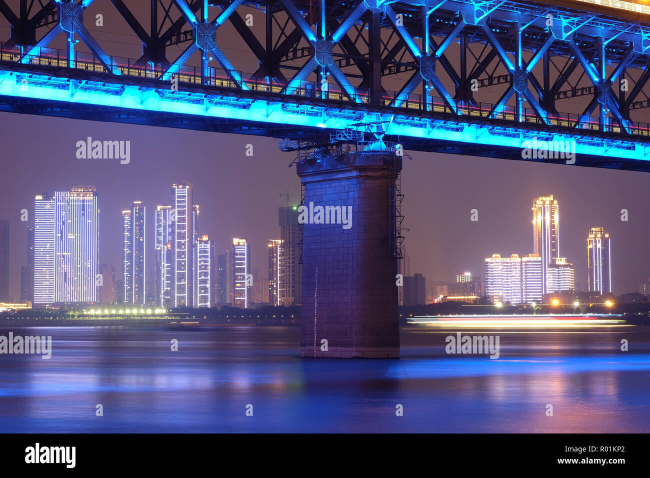 Wuhan, China, October 21st, 2017 Night time at double deck bridge at Wuhan Yangtze River Bridge. It's famous for travel. Many people come to relax at  - Stock Image