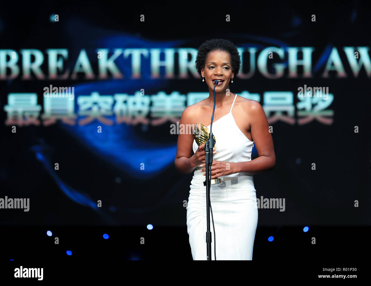 Los Angeles, USA. 30th Oct, 2018. Actress Kelsey Scott who won the Most Influential Award, receives the trophy during the awarding ceremony of the 14th Chinese American Film Festival (CAFF) in Los Angeles, the United States, Oct. 30, 2018. The 14th Chinese American Film Festival (CAFF) kicked off Tuesday at the Ricardo Montalban Theater in Hollywood in the U.S. city of Los Angeles. Credit: Li Ying/Xinhua/Alamy Live News - Stock Image