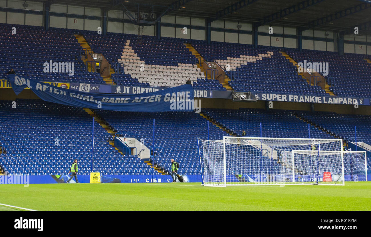 London, UK. 31st October, 2018. A flag is placed over Frank Lampard & John Terry banners then removed ahead of the Carabao Cup round of 16 match between Chelsea and Derby County at Stamford Bridge, London, England on 31 October 2018. Photo by Andy Rowland. Credit: Andrew Rowland/Alamy Live News./Alamy Live News - Stock Image