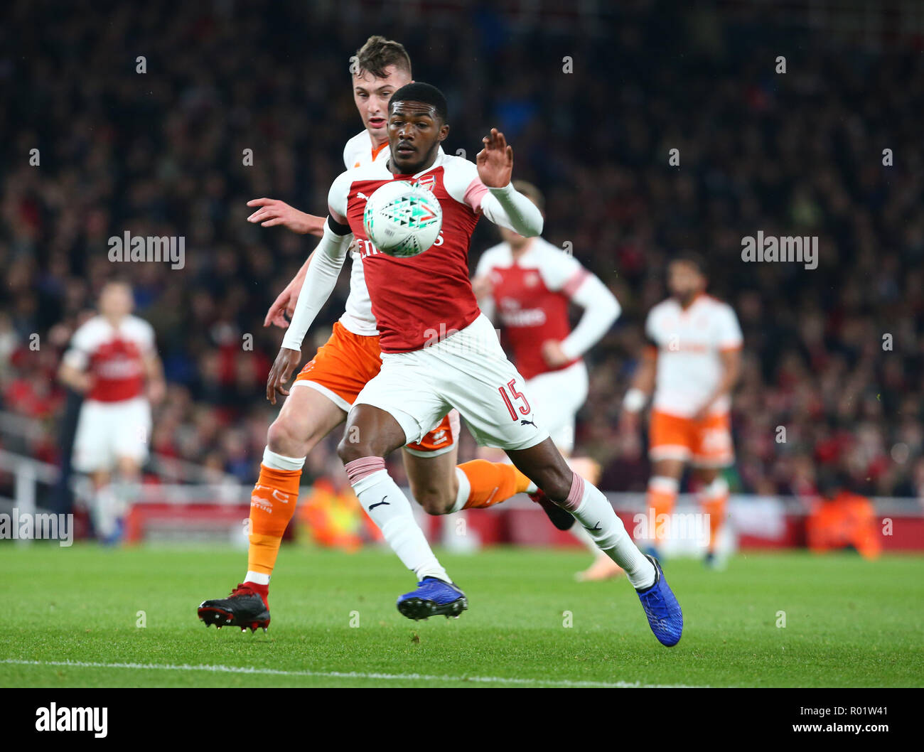 London, UK, 31 October, 2018 Ainsley Maitland-Niles of Arsenal holds ofBlackpool's Paudie O'Connor during EFL Cup Fourth Round  between Arsenal and Blackpool at Emirates stadium , London, England on 31 Oct 2018.  Credit Action Foto Sport Credit: Action Foto Sport/Alamy Live News - Stock Image