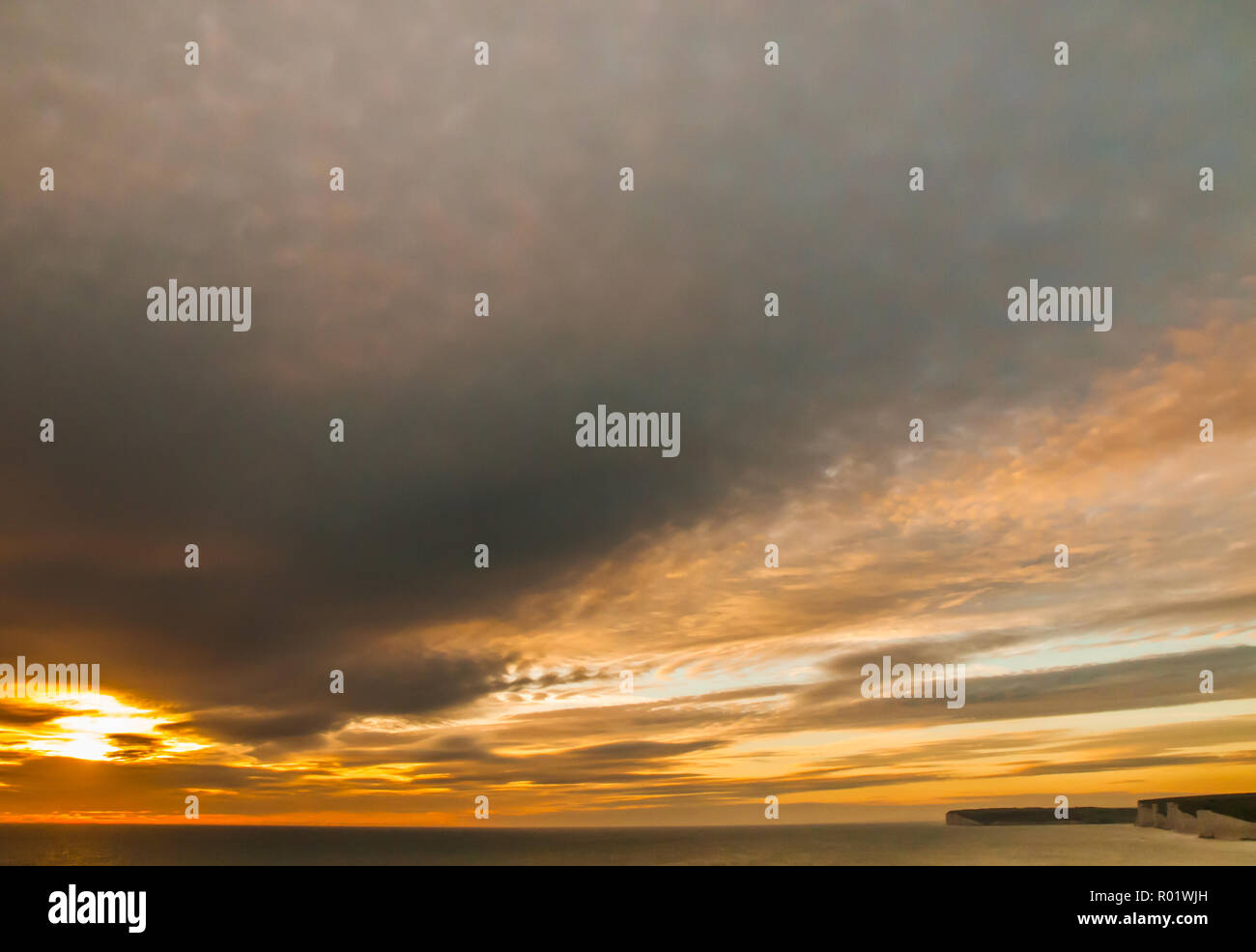 Birling Gap, Eastbourne, East Sussex, UK..31 October 2018..Interesting clouds at sunset create glorious colours in the sky. Seven Sisters chalk cliffs on Right of picture. A tad warmer tonight with wind from the South East ..David Burr/Alamy Live News - Stock Image