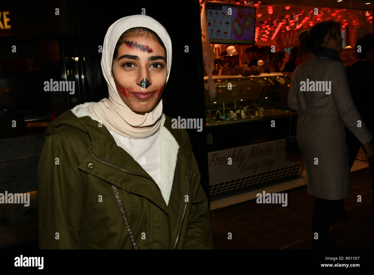 London, UK. 31st Oct, 2018. A lady wearing hijab with Halloween face painting a night in Westend on 31 October 2018, London, UK. Credit: Picture Capital/Alamy Live News Stock Photo