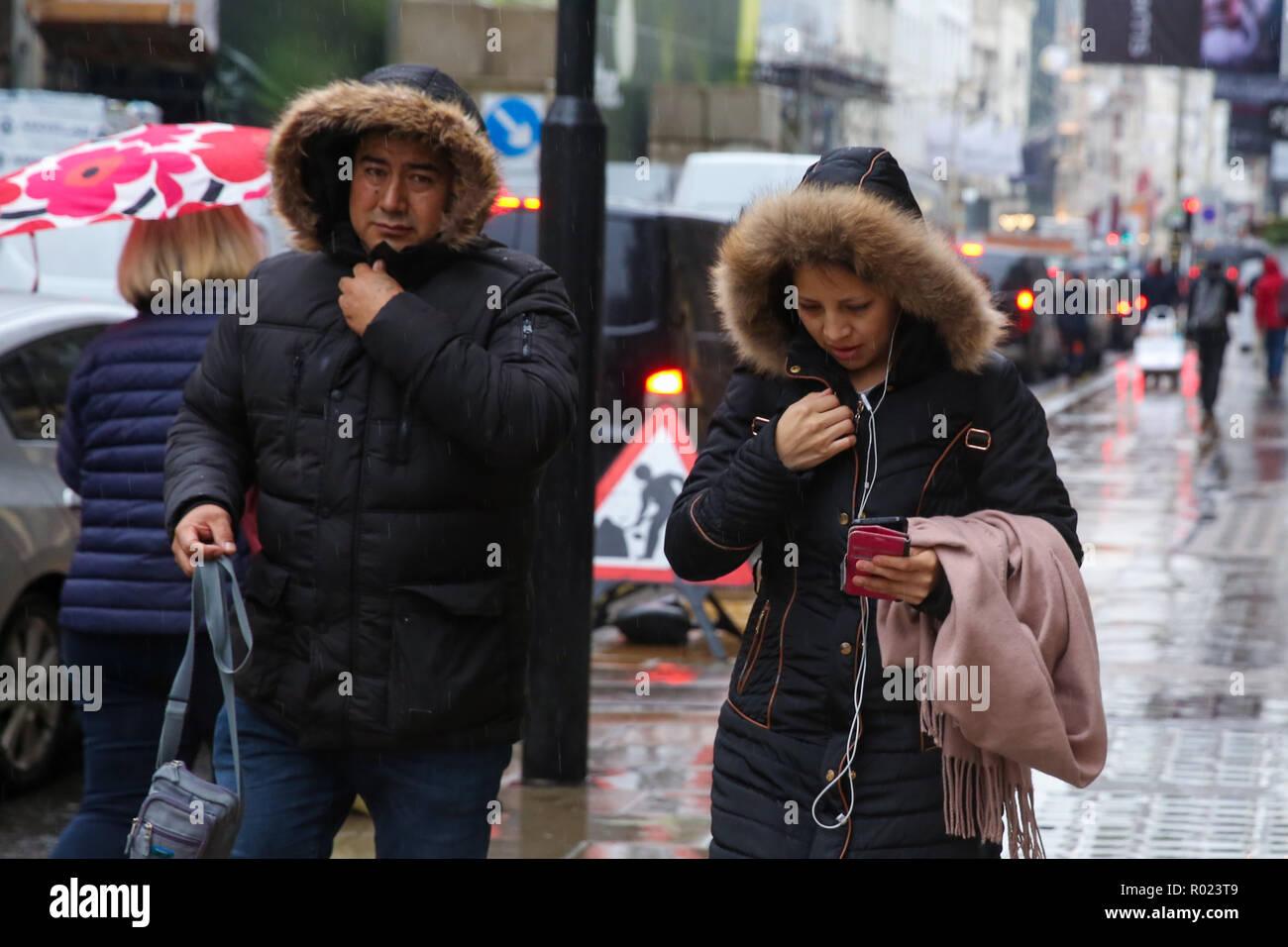 Oxford Street, London, UK. 1st Nov, 2018. Shoppers shelter from the rain beneath umbrellas as rain falls in London. Credit: Dinendra Haria/Alamy Live News Stock Photo