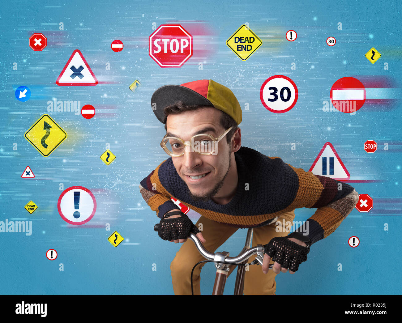 Young guy with stylish outlook and highway code on the background - Stock Image