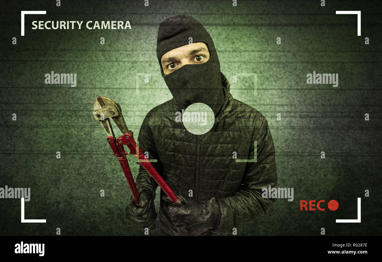 Caught burglar by house camera in action. - Stock Image