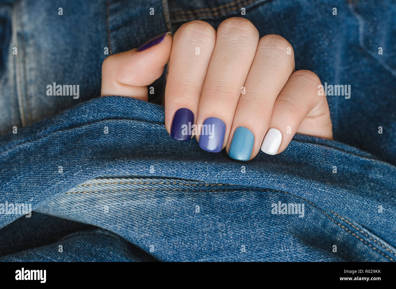Blue Nail Design Beautiful Female Hand With Different Shades Of Blue Manicure Stock Photo Alamy