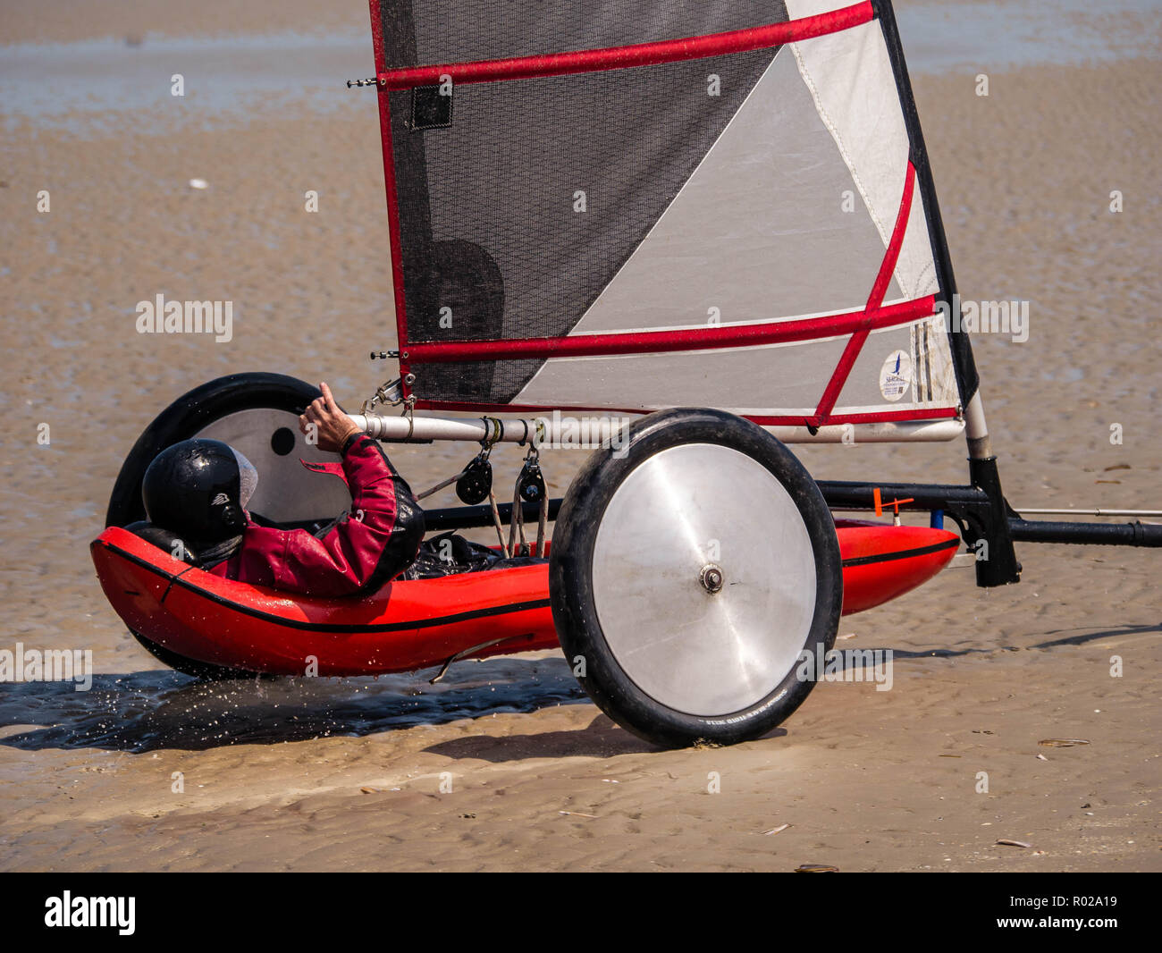 Close-up of a fast moving sand yacht at the beach - Stock Image