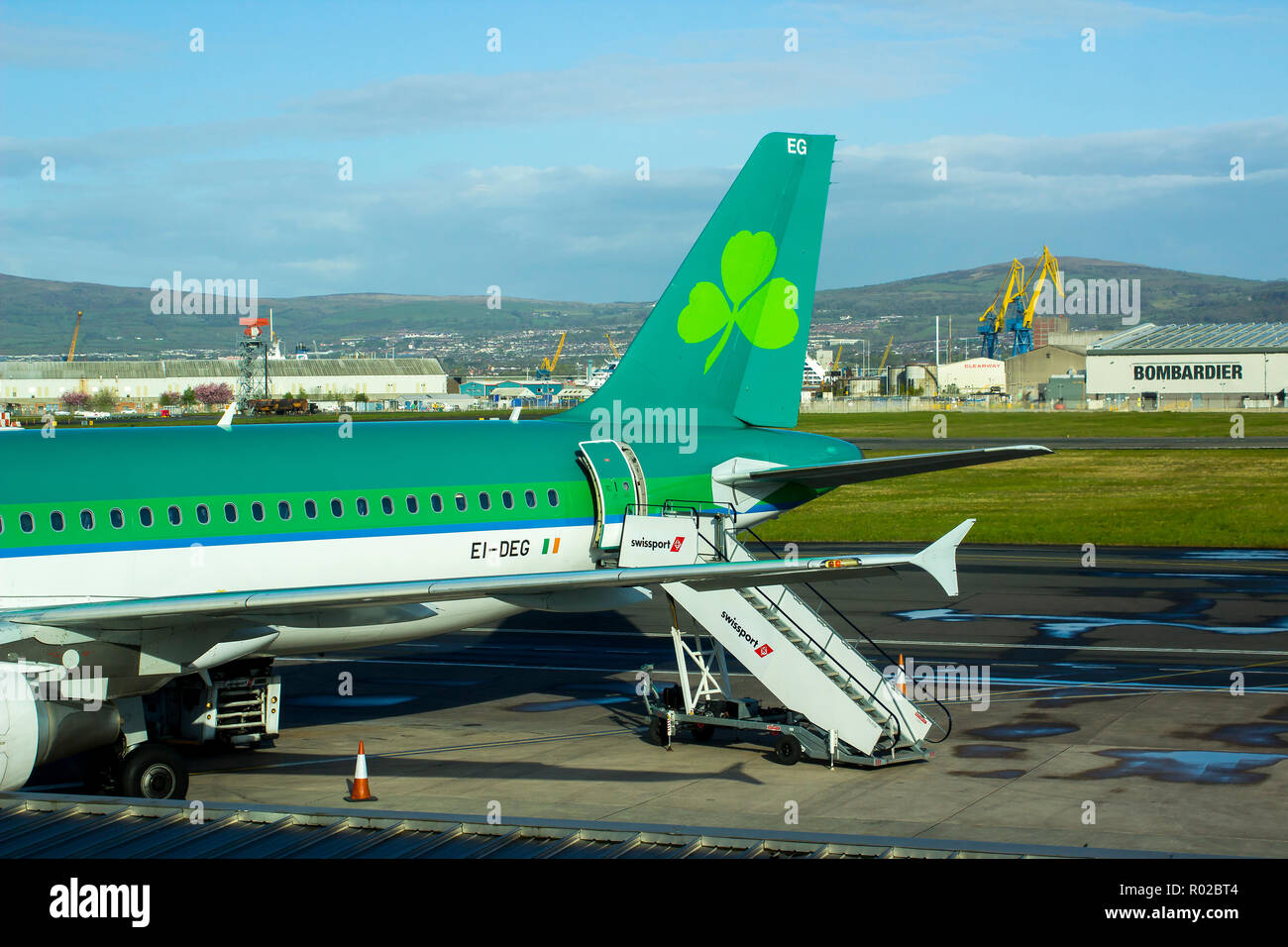 2 May 2018 An Aer Lingus jet with livery sits on the apron at Belfast City Airport in preparation for passenger boarding. - Stock Image