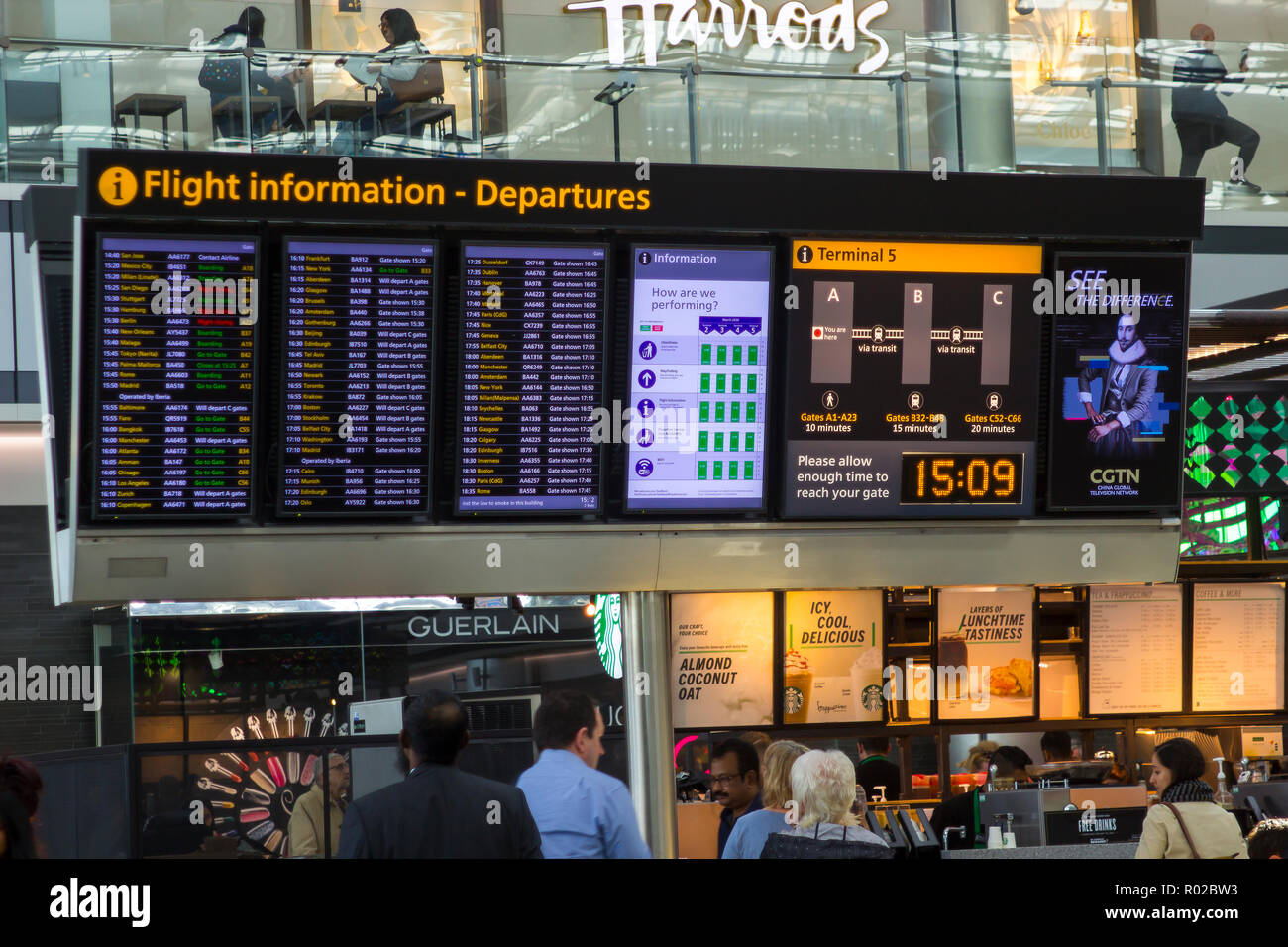2 May 2018 A large flight information digital display board at Terminal 5 departures in Heathrow Airport England, This busy airport is one of the larg - Stock Image