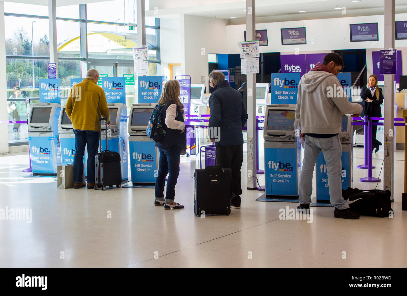 2 May 2018 Busy Flybe self check in desks at the George Best Belfast City Airport in Northern Ireland. Passengers with hand luggage only take the spee - Stock Image