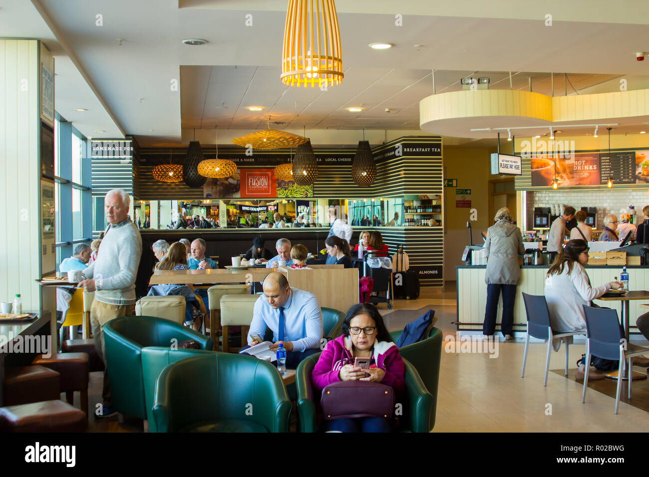 2 May 2018 Passengers taking refreshments at the Fusion Restaurant in Belfast City Airport in Northern Ireland as they await their flight departure ti - Stock Image