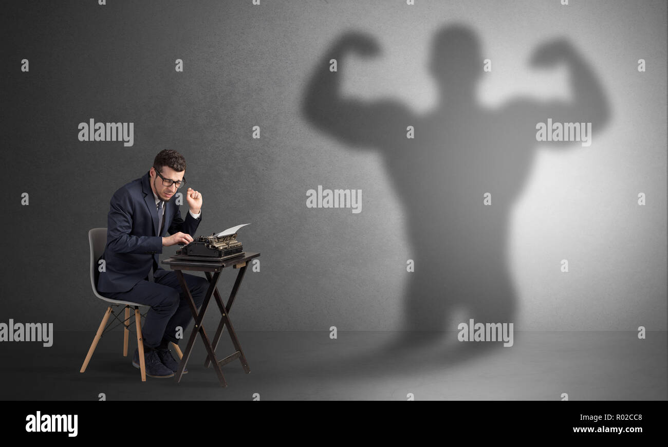 Little hard worker afraid of scary monster shadow  - Stock Image