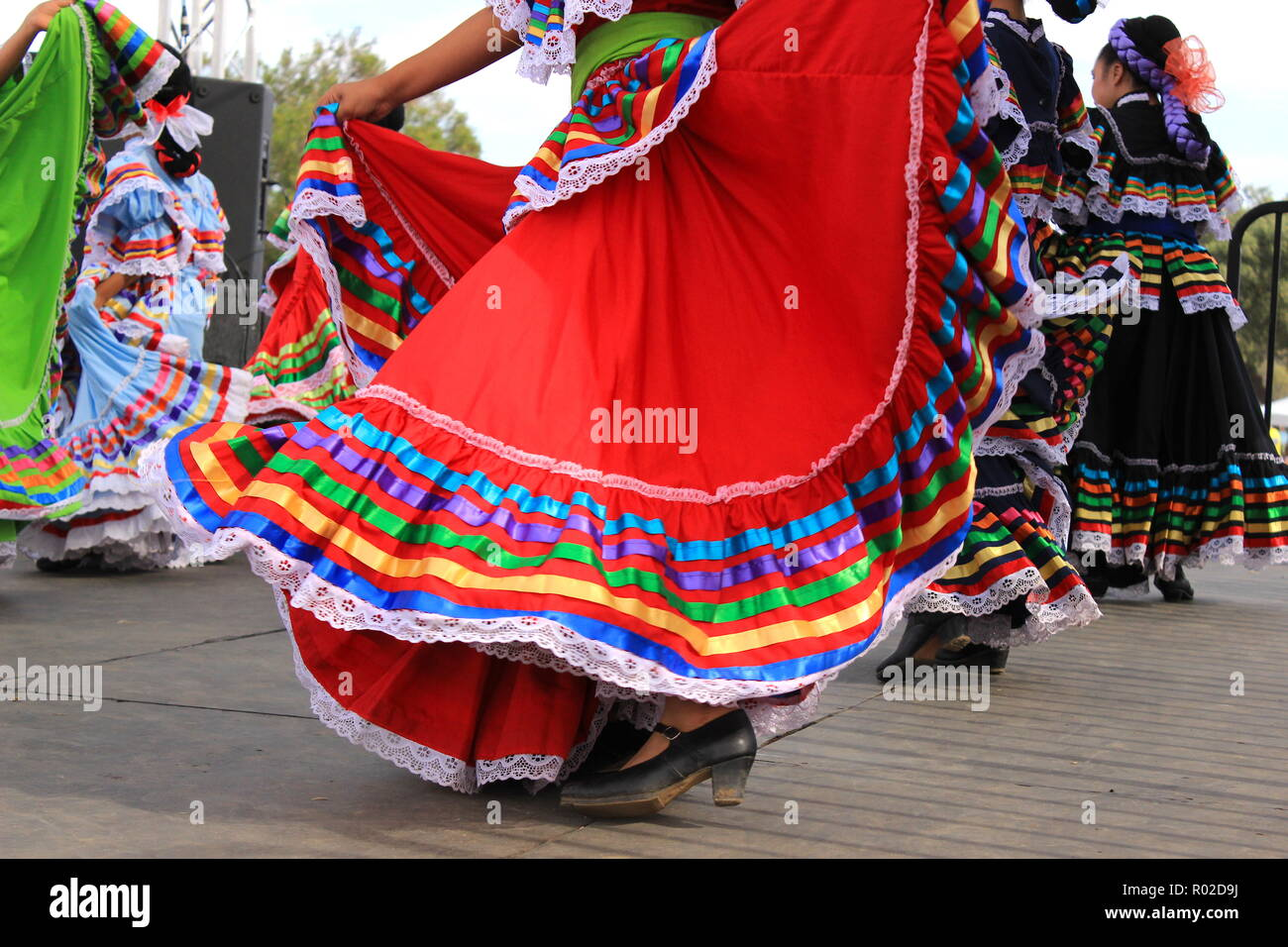 Colorful skirts fly during traditional Mexican dancing - Stock Image