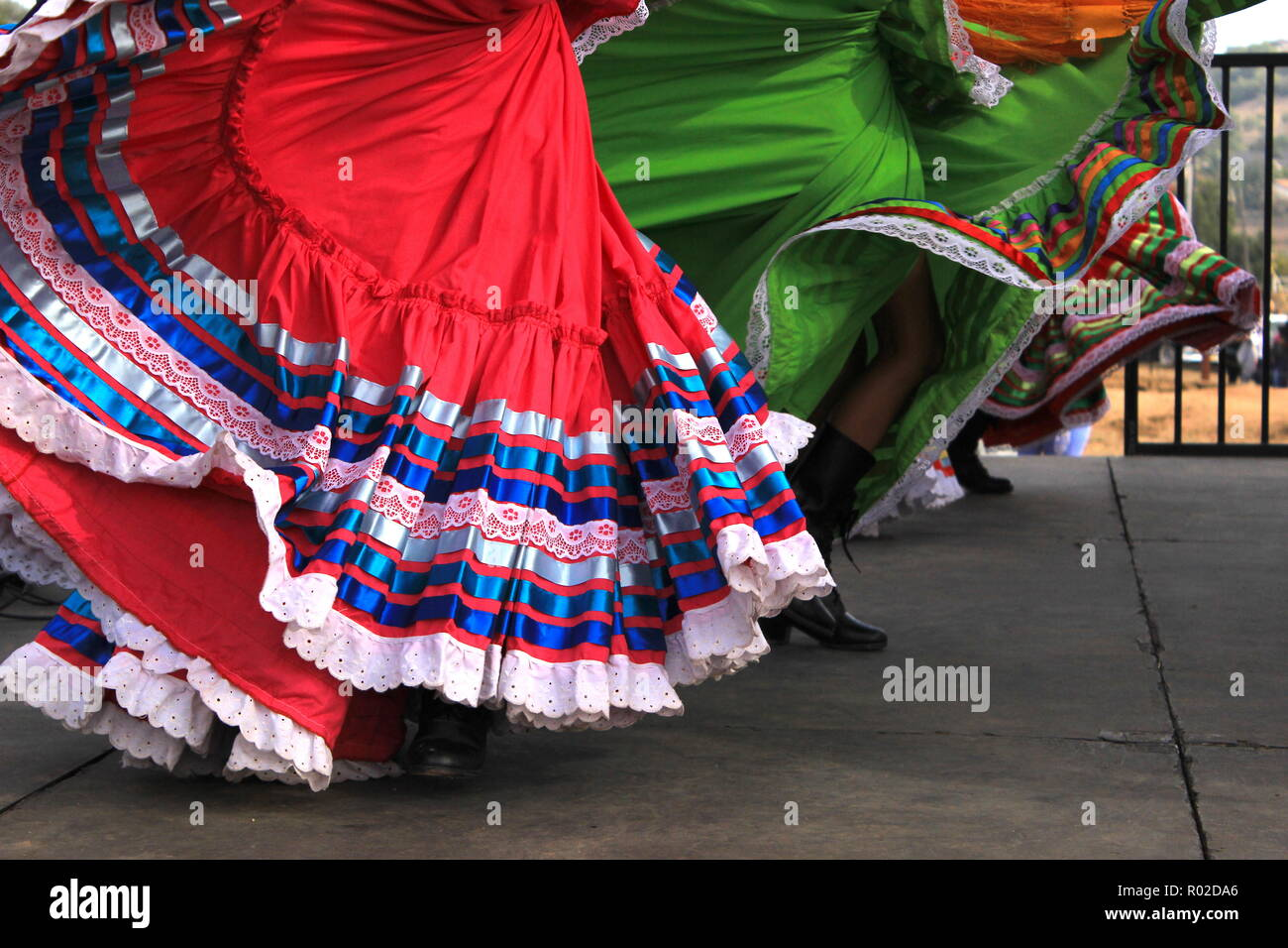 Colorful skirts fly during traditional Mexican dancing Stock Photo