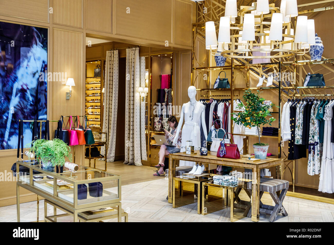 64100c31659 London England United Kingdom Great Britain Mayfair Tory Burch shopping  store designer boutique upmarket women s fashion handbags clothing Asian  woman
