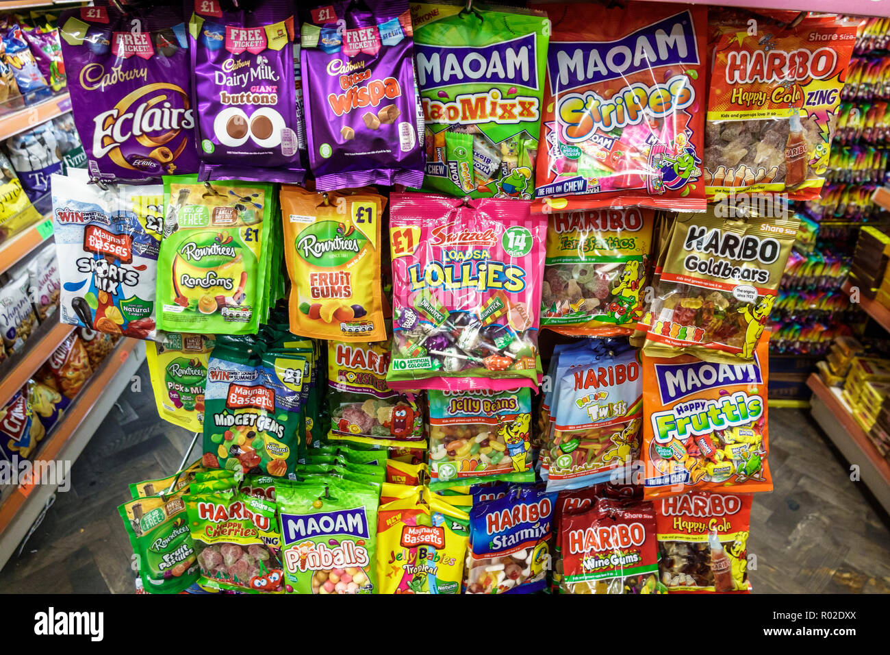 London England United Kingdom Great Britain Lambeth South Bank convenience store shop snacks display sale candy junk food Maoman Cadbury Haribo fruit - Stock Image