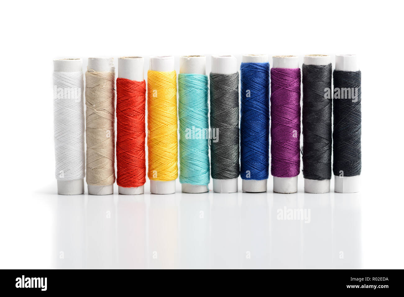 Row set of color sewing threads isolated - Stock Image