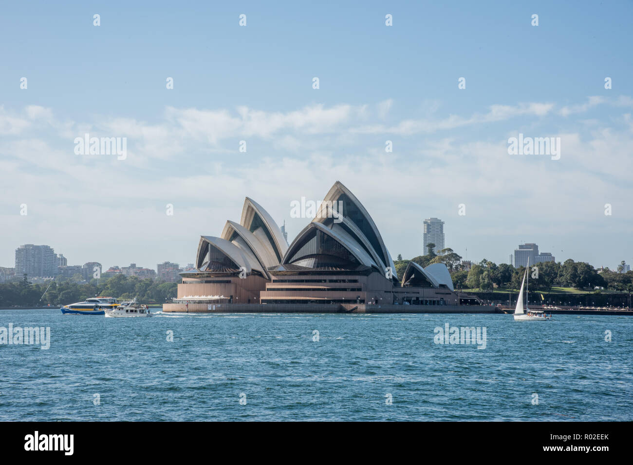 Sydney, New South Wales, Australia-December 21,2016: Sydney Opera House and nautical vessels with tourists in Sydney, Australia - Stock Image
