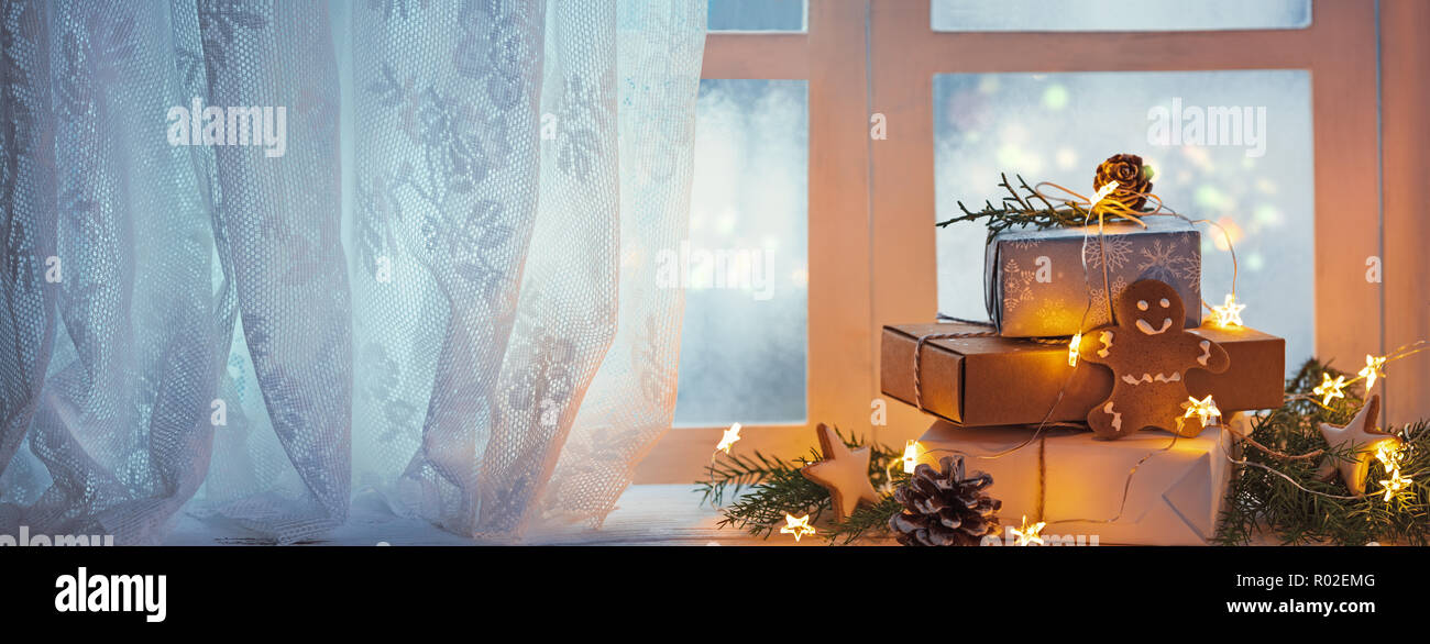 Merry Christmas and happy holidays Window with gift boxes and lights,new year decoration. - Stock Image
