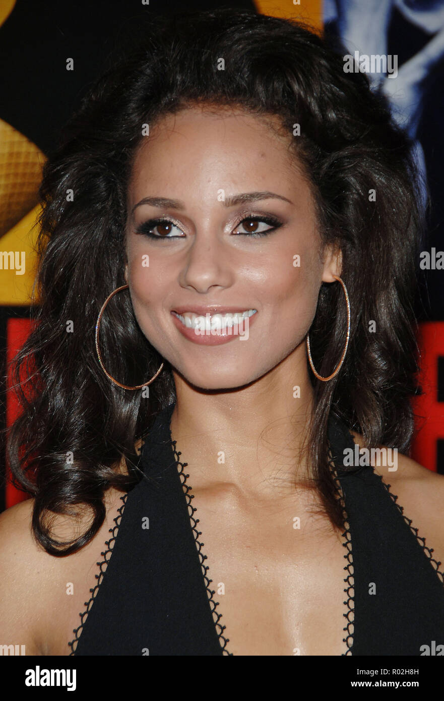 Alicia Keys arriving at the Smokin' Aces at the Chinese Theatre In Los Angeles. January 18, 2007.  smile portrait headshot KeysAlicia029 Red Carpet Event, Vertical, USA, Film Industry, Celebrities,  Photography, Bestof, Arts Culture and Entertainment, Topix Celebrities fashion /  Vertical, Best of, Event in Hollywood Life - California,  Red Carpet and backstage, USA, Film Industry, Celebrities,  movie celebrities, TV celebrities, Music celebrities, Photography, Bestof, Arts Culture and Entertainment,  Topix, headshot, vertical, one person,, from the year , 2007, inquiry tsuni@Gamma-USA.com - Stock Image