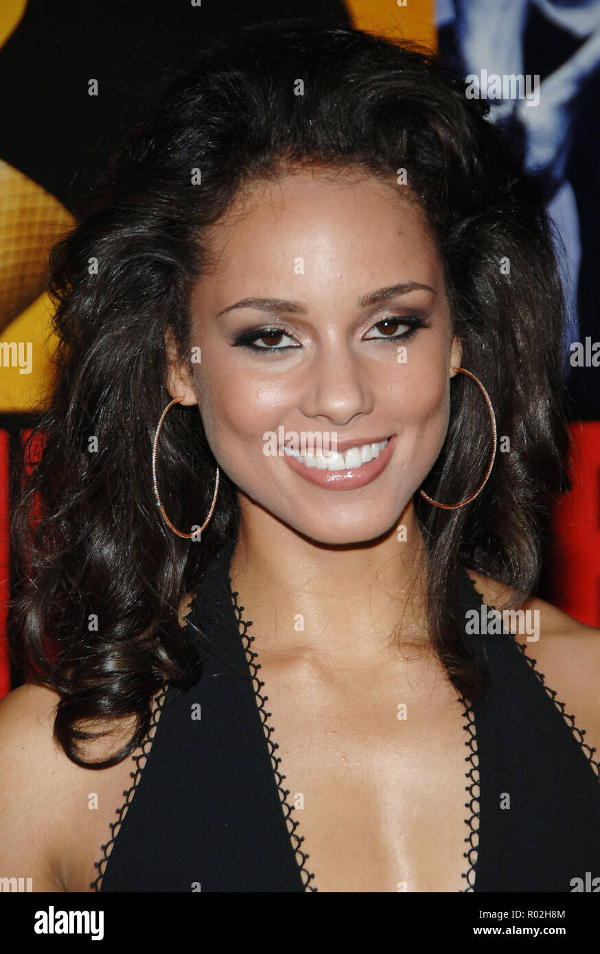 Alicia Keys arriving at the Smokin' Aces at the Chinese Theatre In Los Angeles. January 18, 2007.  eye contact smile portrait headshot KeysAlicia030 Red Carpet Event, Vertical, USA, Film Industry, Celebrities,  Photography, Bestof, Arts Culture and Entertainment, Topix Celebrities fashion /  Vertical, Best of, Event in Hollywood Life - California,  Red Carpet and backstage, USA, Film Industry, Celebrities,  movie celebrities, TV celebrities, Music celebrities, Photography, Bestof, Arts Culture and Entertainment,  Topix, headshot, vertical, one person,, from the year , 2007, inquiry tsuni@Gamma - Stock Image
