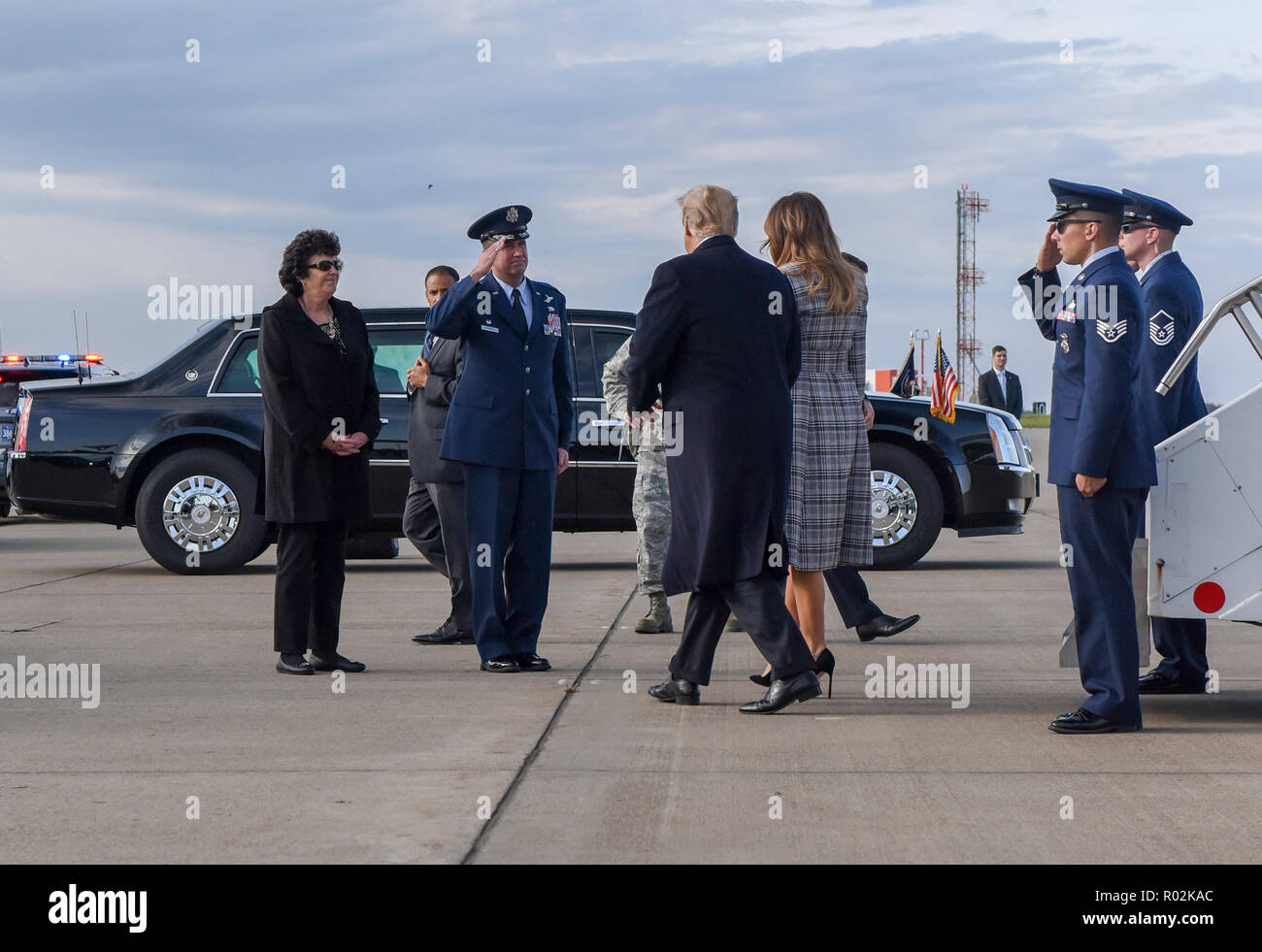 171st Air Refueling Wing Commander Col. Mark Goodwill salutes President Donald Trump and First Lady Melania Trump as they exit Air Force One near Pittsburgh, Oct. 30, 2018. President Trump's visit to Pittsburgh came after 11 people lost their lives in an anti-semitic attack in Squirrel Hill, Oct. 27, 2018. (U.S. Air National Guard photo by Staff Sgt. Bryan Hoover) Stock Photo