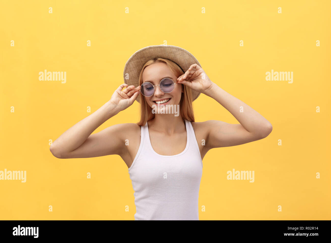f3b3dd32862 Happy cheerful young woman wearing white t-shirt rejoicing at positive news  or birthday gift