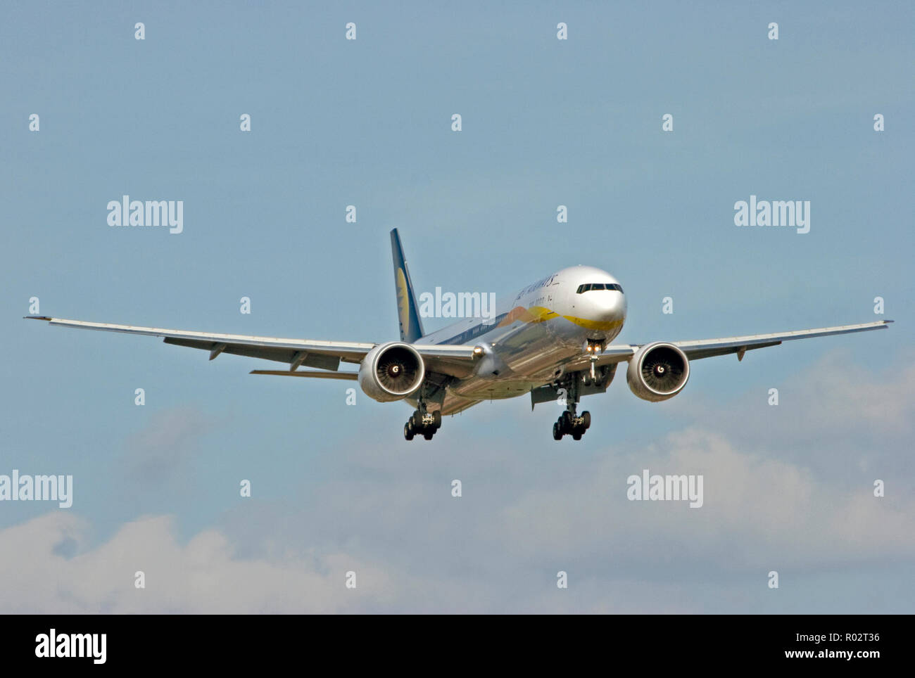 Jet Airways Boeing 777-35RER landing at London Heathrow airport. - Stock Image