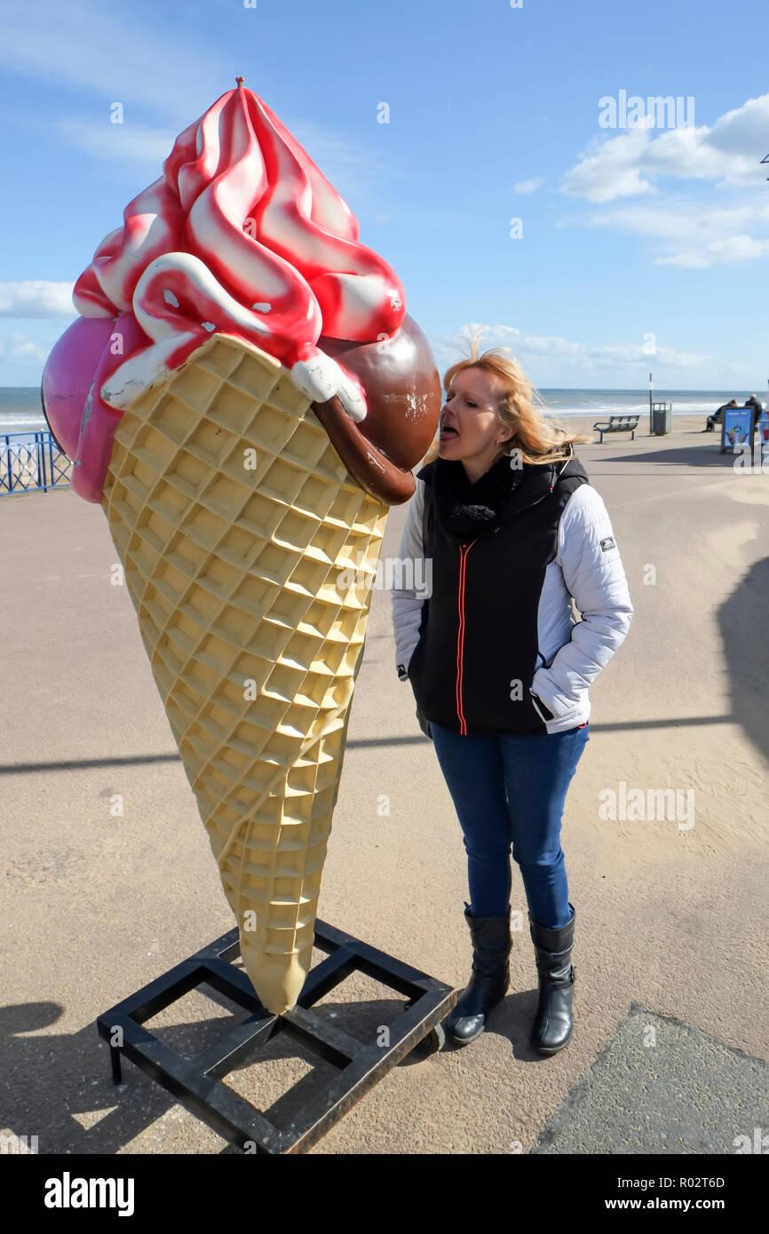 icecream, ice cream, eating ice cream, giant ice cream, Mablethorpe Lincolnshire UK England, huge ice cream, ice creams, ice cream cornet, licking - Stock Image