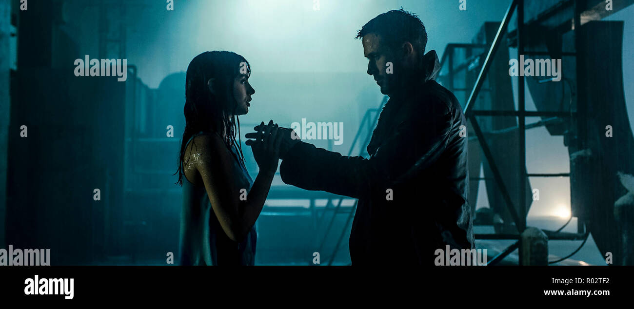 'K' (Ryan Gosling) and his holographic companion Joi (Ana de Armas) from Blade Runner 2049 (2017) directed by Denis Villeneuve. A sequel to the 1982 classic set thirty years later where a new blade runner uncovers a secret. - Stock Image