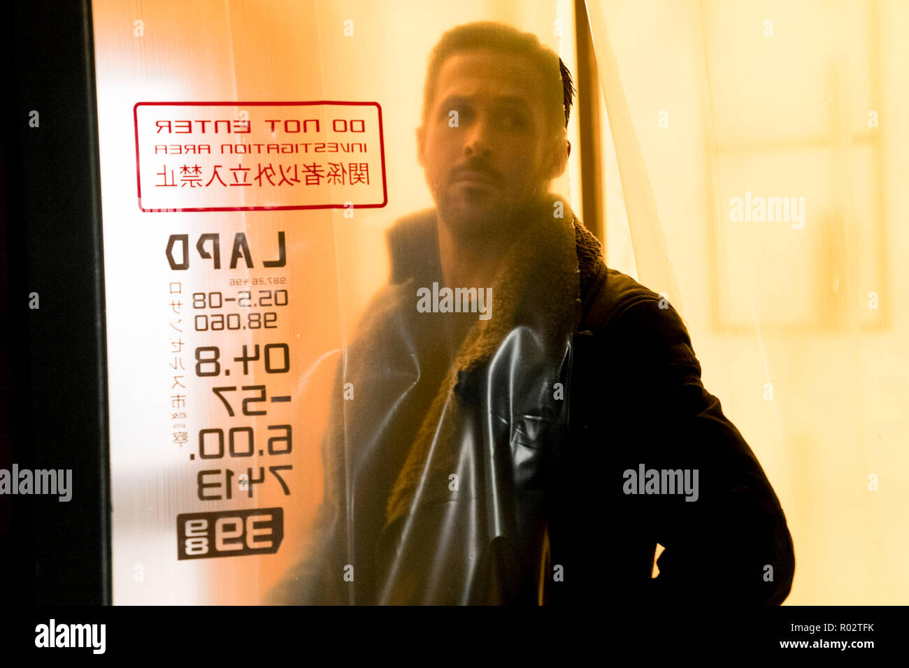 'K' (Ryan Gosling) revisiting a crime scene from Blade Runner 2049 (2017) directed by Denis Villeneuve. A sequel to the 1982 classic set thirty years later where a new blade runner uncovers a secret. - Stock Image