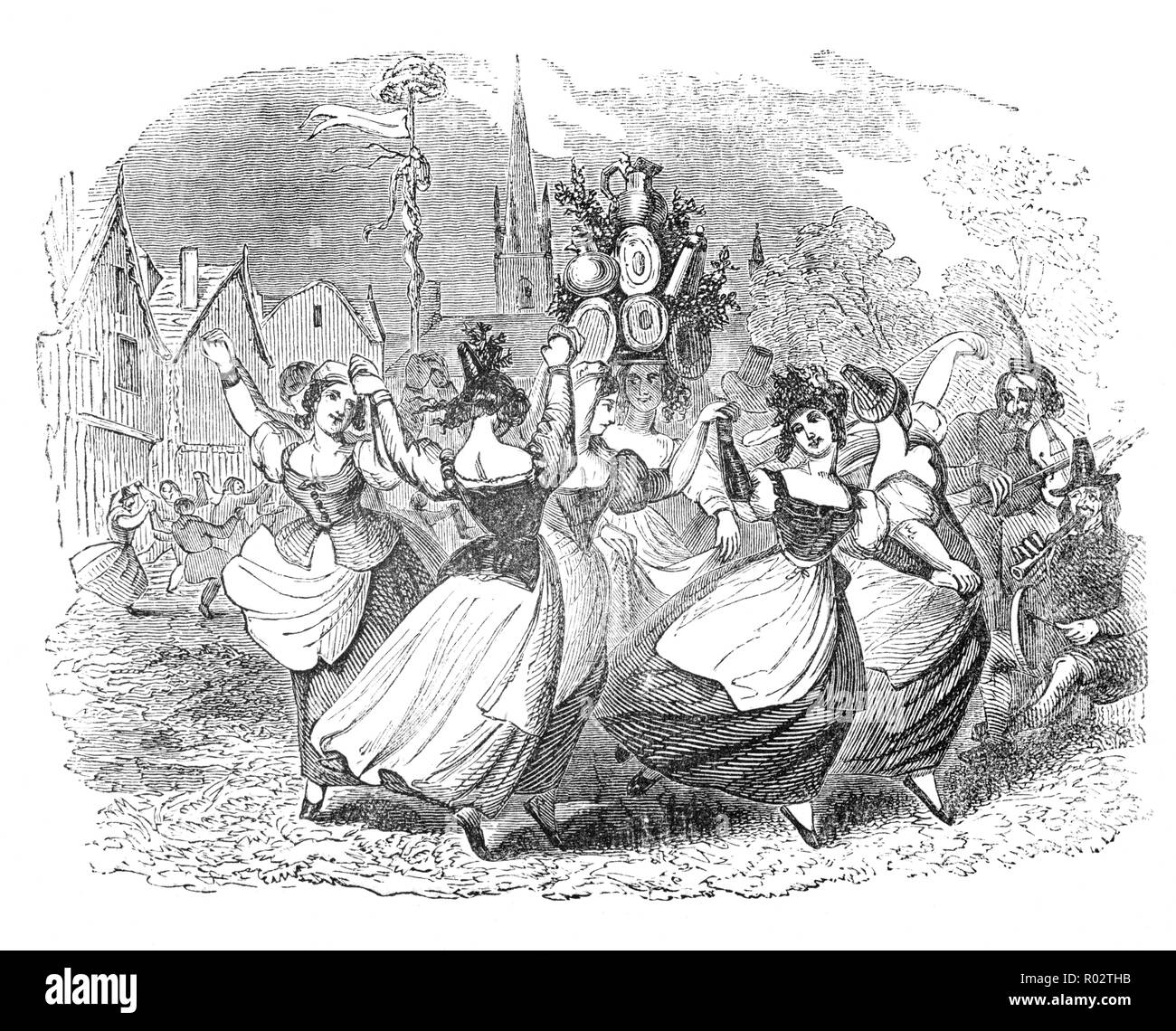 The Milkmaids Dance: During the medieval English May Day festival, milkmaids danced round a garlanded obelisk of massive plate, covered with silk and carried on a horse. The most showy flowers of the season were arranged so as to fill up the openings between the dishes, plates and tankards etc. The obelisk was carried by two chairmen, in gold-laced hats, six or more handsome milkmaids in pink and blue gowns, yellow or scarlet petticoats; high-heeled shoes; laced mob-caps;  and flat Woffington hats covered with ribbons of every color. A magnificent silver tea-urn surmounted the obelisk. - Stock Image