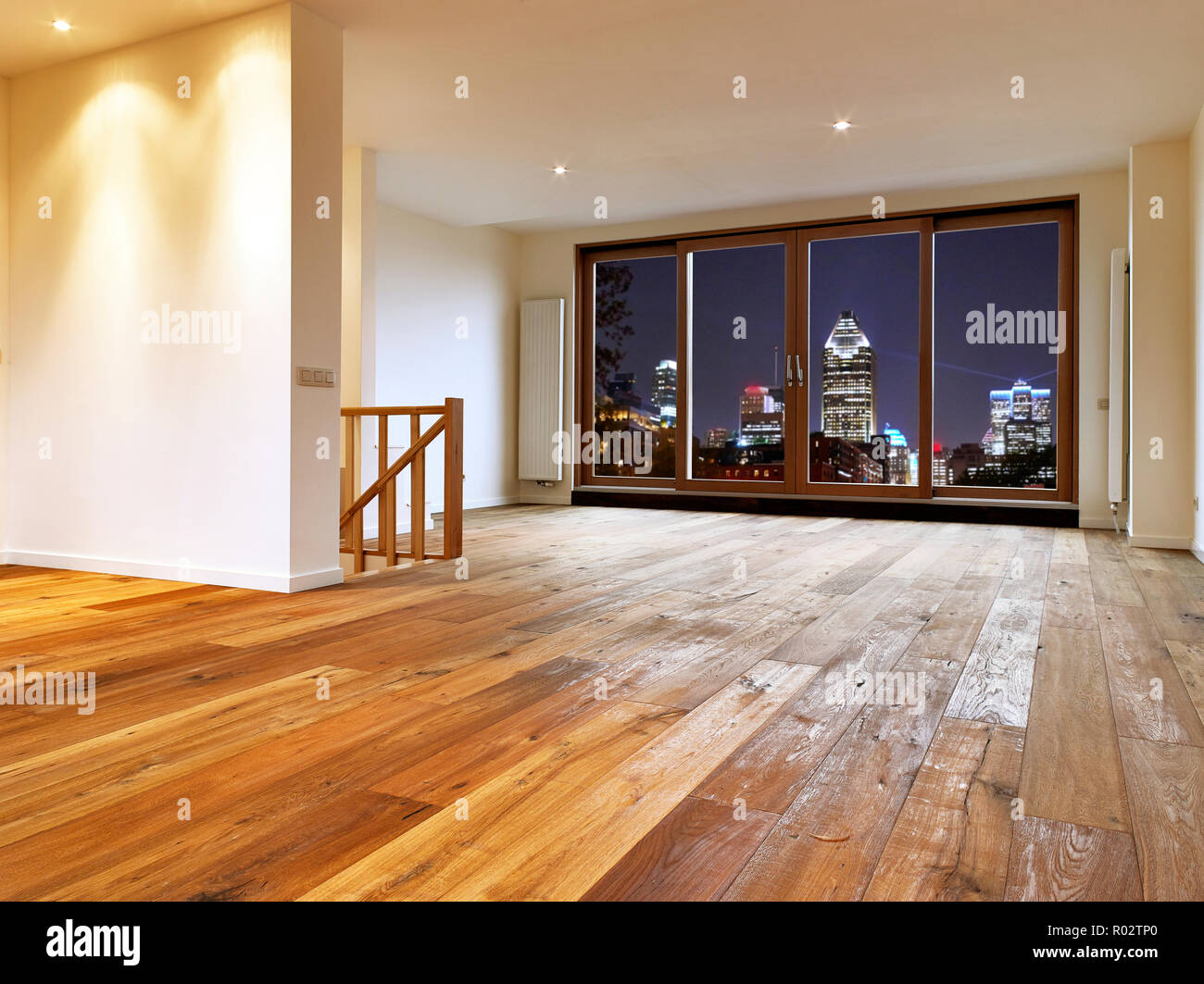 Empty Big Living Room Interior With Wooden Floor And View On Night City  Lights