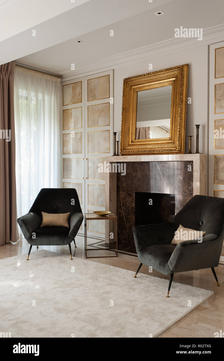 Poltrone Da Camino Moderne.Armchairs By Fireplace In Masculine Bedroom Stock Photo