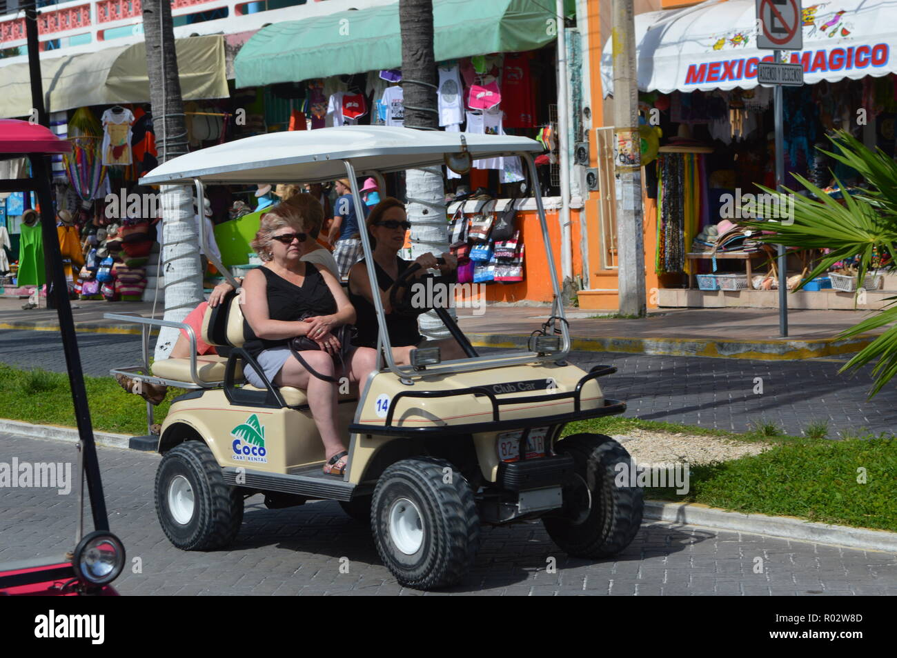 Walk through the streets of Islas Mujeres in a golf cart. Stock Photo
