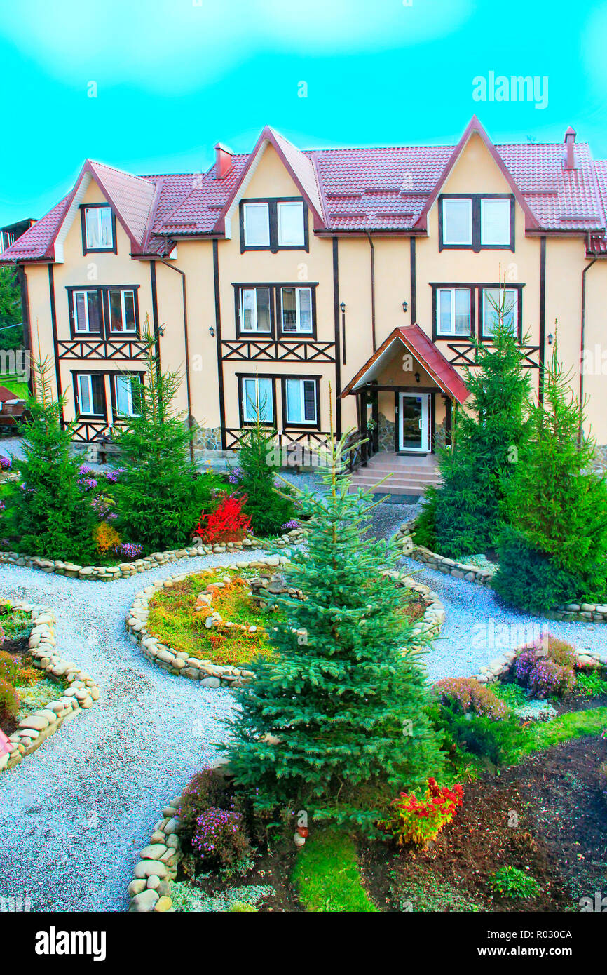 Modern Building Of Holiday Home In Carpathians With Flower Beds And