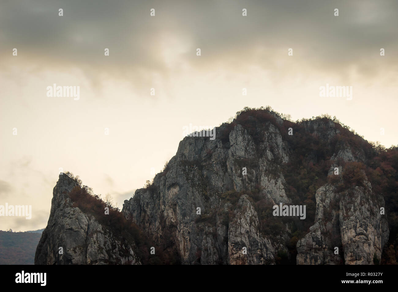 Moody view of iconic mountain over village Vlasi in Serbia, near Pirot, during twilight - Stock Image