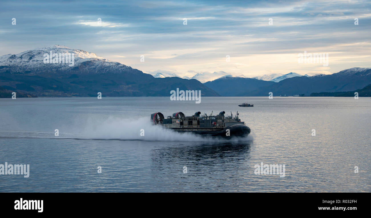181031-N-JS726-0761    NORWEGIAN SEA (Oct. 31, 2018) A landing craft, air cushion, attached to Assault Craft Unit 4, conducts ship-to-shore operations in the Alvund Fjord with the Wasp-class amphibious assault ship USS Iwo Jima (LHD 7) during Trident Juncture 2018, Oct. 31, 2018. Trident Juncture 2018 is a NATO-led exercise designed to certify NATO response forces and develop interoperability among participating NATO Allies and partner nations. (U.S. Navy photo by Chief Mass Communication Specialist David Holmes/Released) Stock Photo