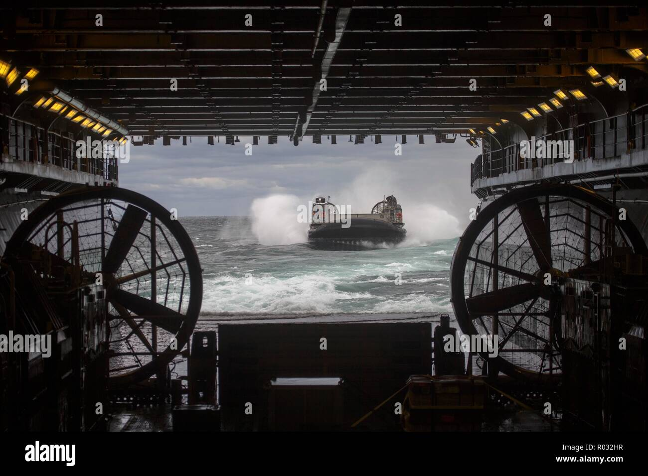 A landing craft, air cushion makes its approach toward the well deck of the USS Kearsarge (LHD 3) during Carrier Strike Group 4 Composite Unit Training Exercise Oct. 27, 2018. COMPTUEX is the final pre-deployment exercise that certifies the combined Kearsarge Amphibious Ready Group and 22nd Marine Expeditionary Unit's abilities to conduct military operations at sea. (U.S. Marine Corps photo by Lance Cpl. Tawanya Norwood) Stock Photo