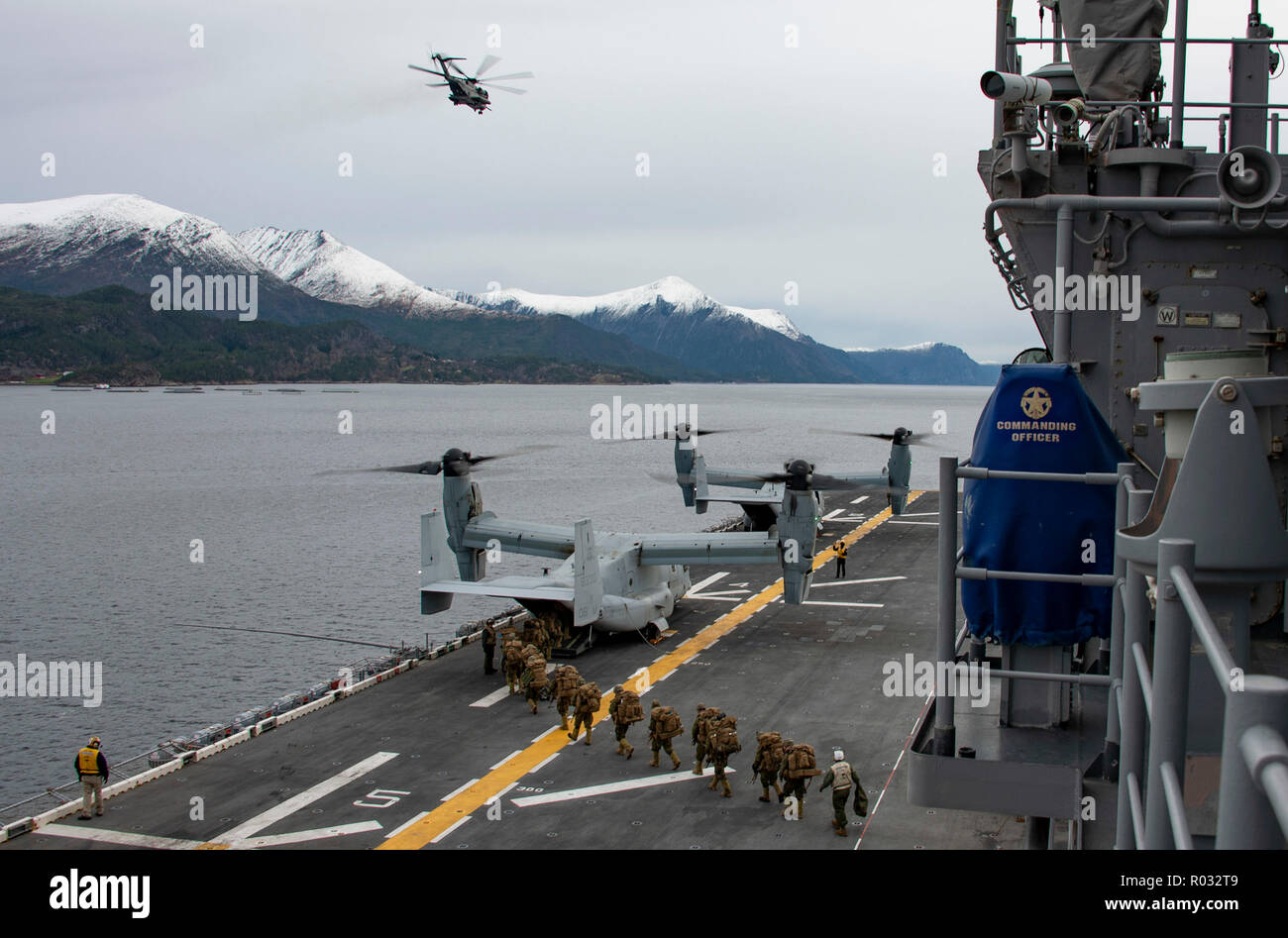 181031-N-JS726-0268    NORWEGIAN SEA (Oct. 31, 2018) Marines assigned to the 24th Marine Expeditionary Unit board an MV-22B Osprey, attached to Marine Medium Tiltrotor Squadron (VMM) 365 (Reinforced), aboard the Wasp-class amphibious assault ship USS Iwo Jima (LHD 7) while conducting operations in the Alvund Fjord during Trident Juncture 2018, Oct. 31, 2018. Trident Juncture 2018 is a NATO-led exercise designed to certify NATO response forces and develop interoperability among participating NATO Allies and partner nations. (U.S. Navy photo by Chief Mass Communication Specialist David Holmes/Re Stock Photo