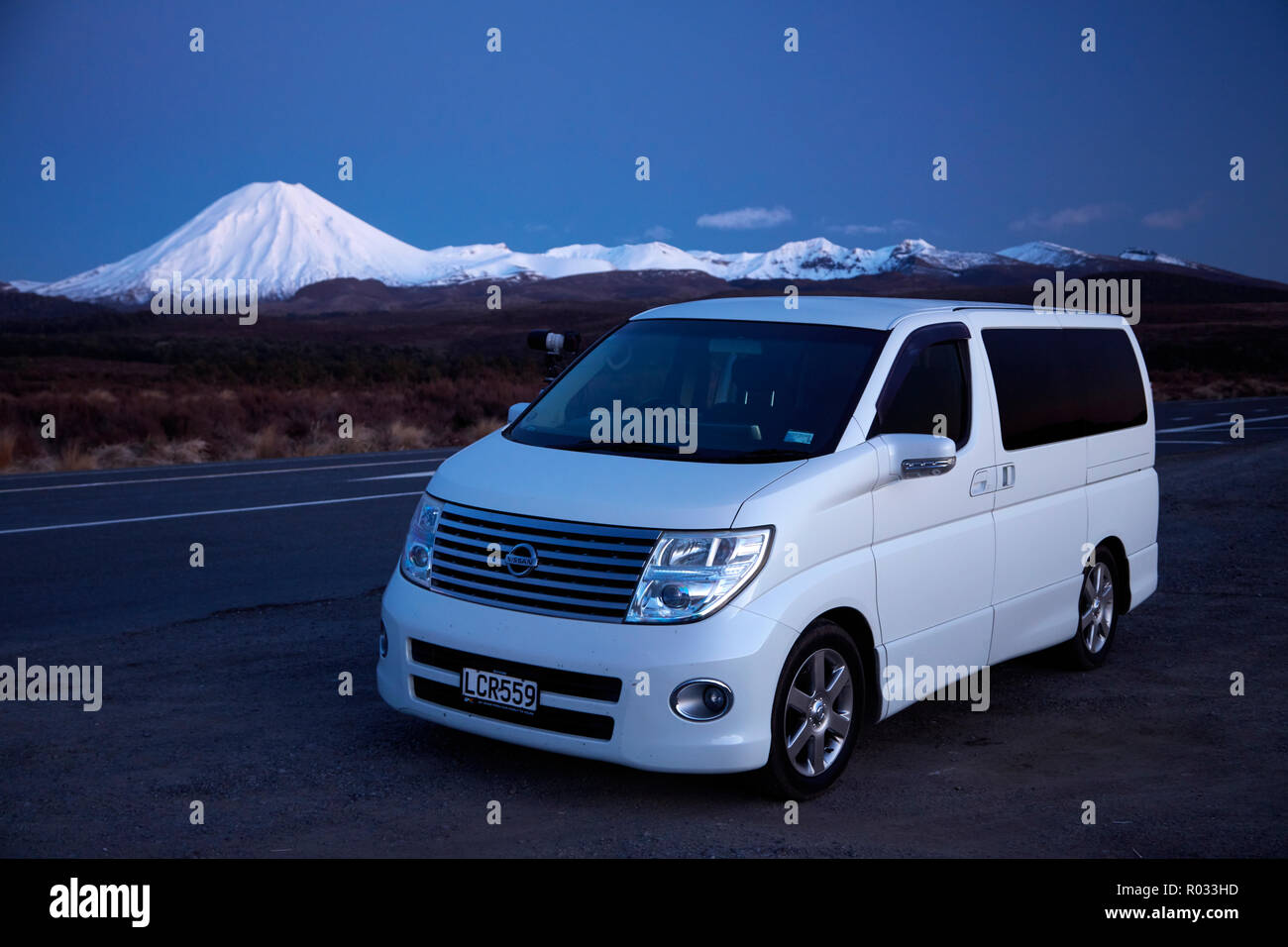 Van on Desert Road and Mt Ngauruhoe, Tongariro National Park, Central Plateau, North Island, New Zealand - Stock Image
