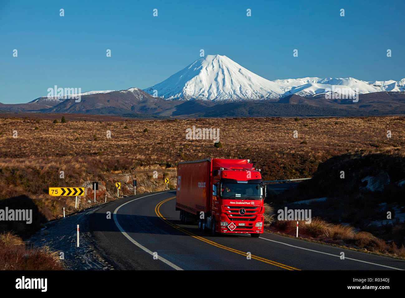 Mt Ngauruhoe and NZ Post truck on Desert Road, Tongariro National Park, Central Plateau, North Island, New Zealand - Stock Image