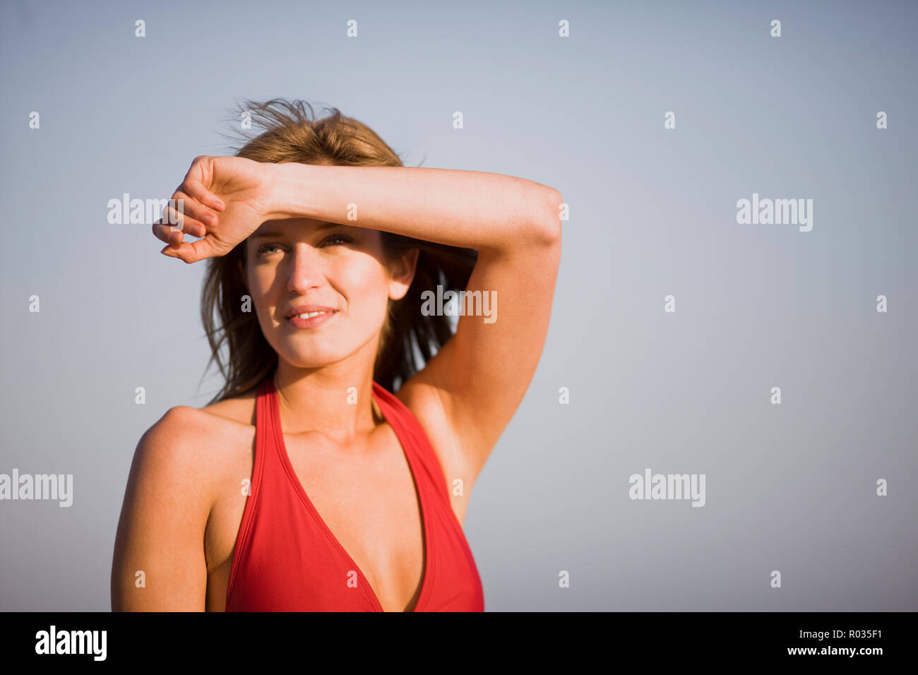 Young blond woman wearing a red bikini - Stock Image