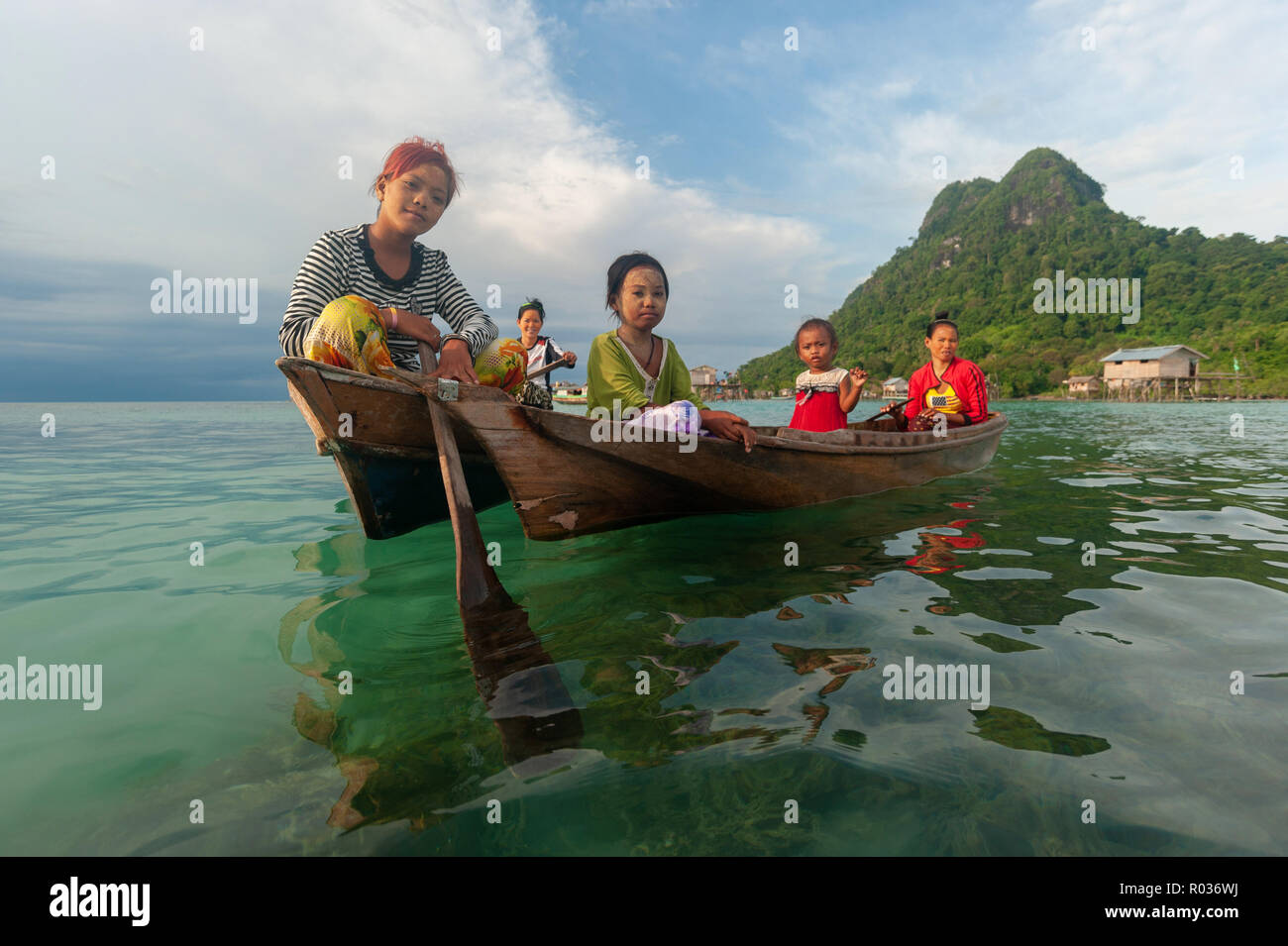 Semporna Sabah Malaysia - Sep 1, 2018 : Group of Sea Bajau ladies greeting visitors from their wooden boat. - Stock Image