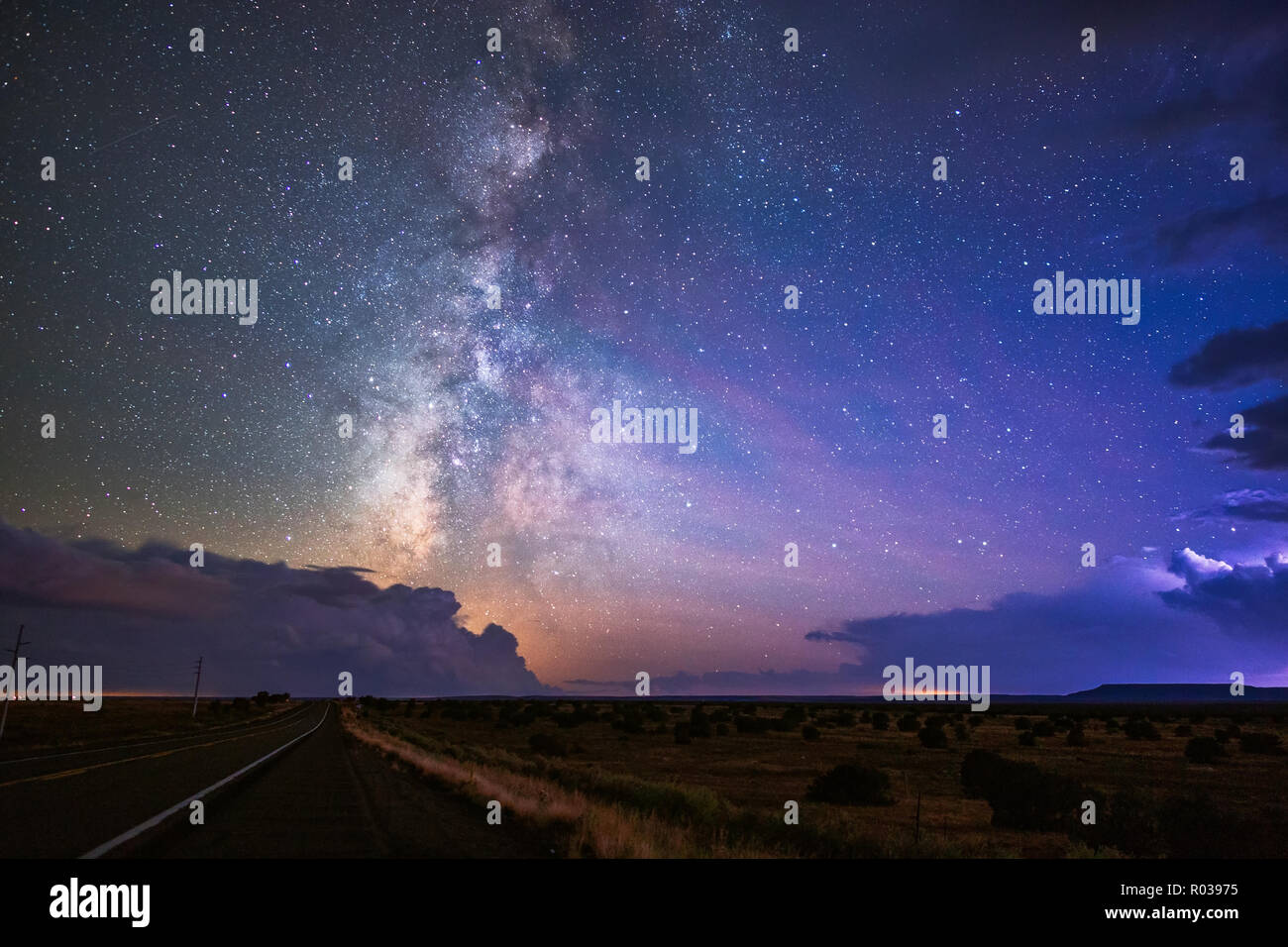 The Milky Way galaxy between a pair of storms in the night sky near Winslow, Arizona. - Stock Image